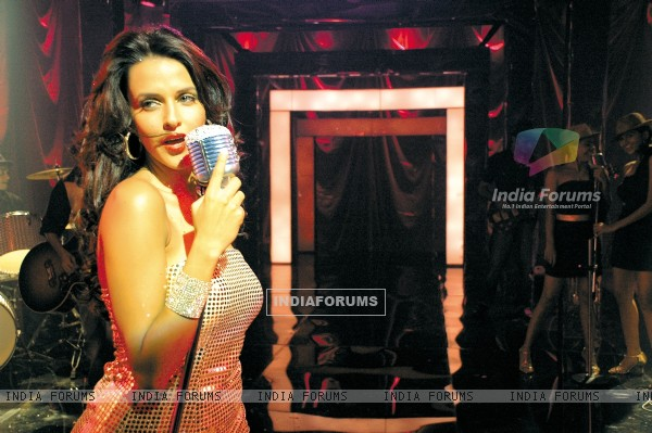 Neha Dhupia singing a song