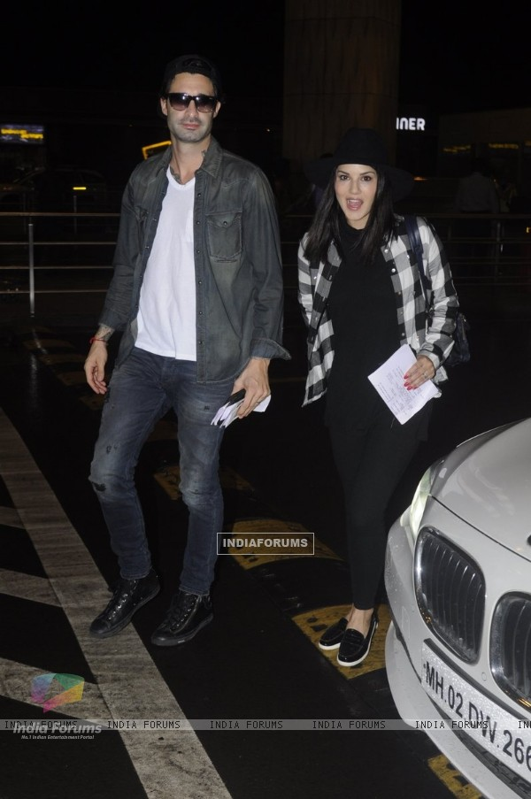 Sunny Leone Snapped with her husband Daniel Weber at Airport