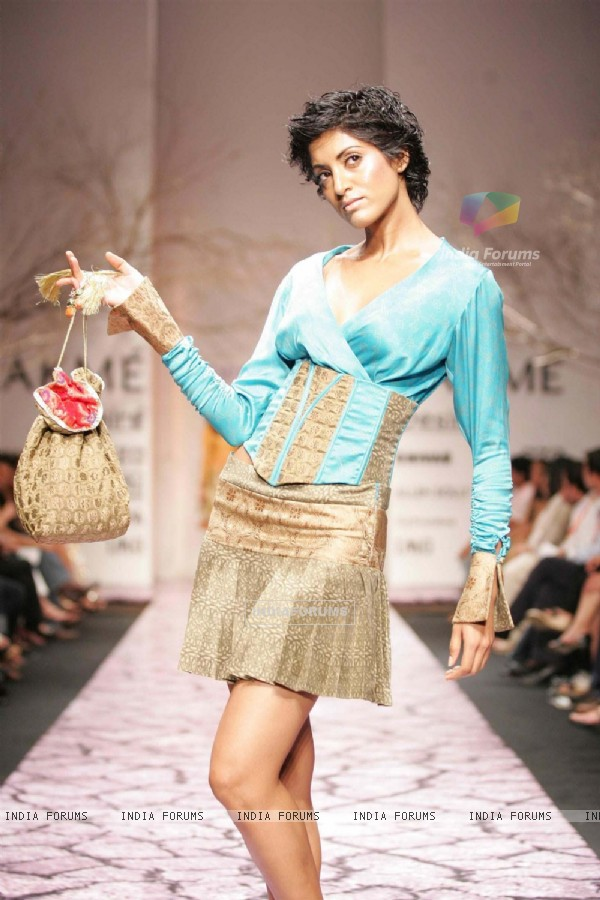 A model displaying Neeta Lulla''s collection at the Lakme Fashion Week in Mumbai