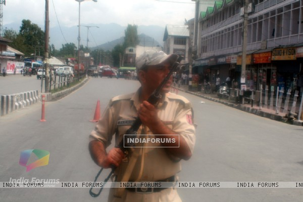 An armed security force personnel near the site of the gun fight with two militants in Srinagar