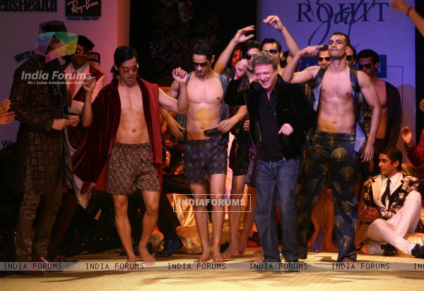 Models and designer Rohit Bal show during the Men''s Fashion Week in New Delhi on Friday 11 September 2009