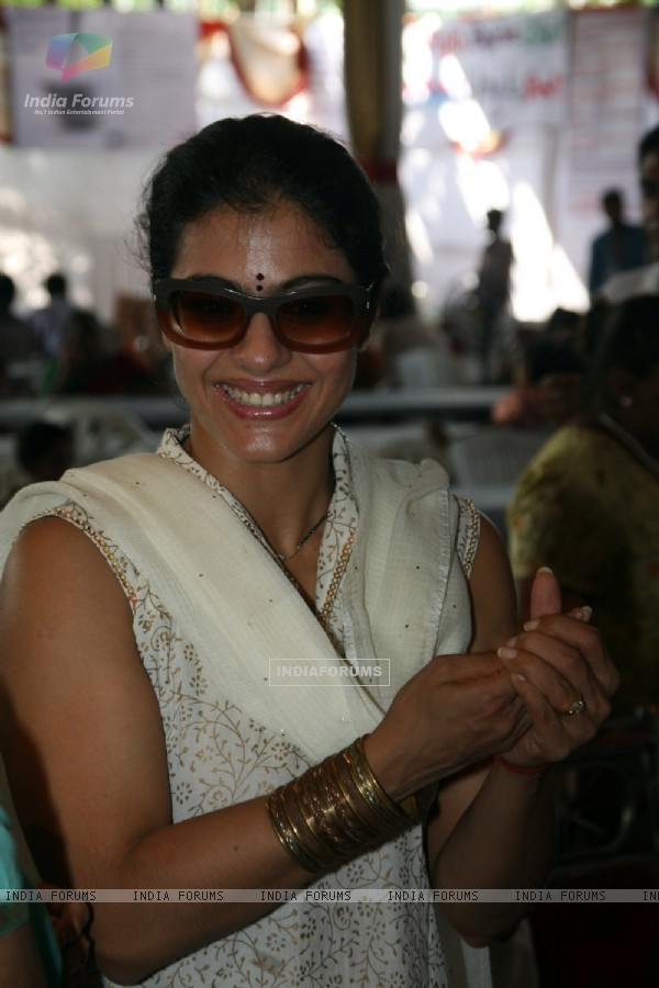 Kajol serves food to Rani Mukherjee at a Durga Pooja pandal in Mumbai