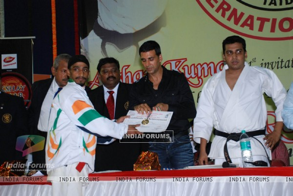 Bollywood Actor Akshay Kumar addresses during 1st Invitational Open National Karate Championship at Andheri Sports Complex, Mumbai on Wednesday, 21 October 2009