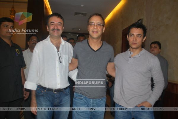 "Producer Vidhu Vinod Chopra, Director Rajkumar Hirani and Aamir Khan were present at the first look of their movie ""3 Idiots"" held at Metro Big Cinemas in Mumbai"