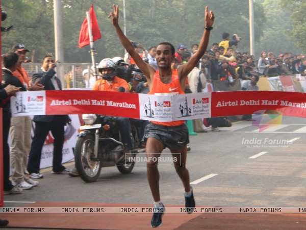 Ethiopian athlete Deriba Merga reaches the finishing line Mergia won the Airtel Delhi Half Marathon for men,in New Delhi on Sunday ( Photo: IANS)