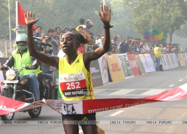 Kenya''s Mary Keitany won the women''s race in the Airtel Delhi Half Marathon , clocking a new record of 66 min:54 sec,in New Delhi on Sunday ( Photo: IANS)