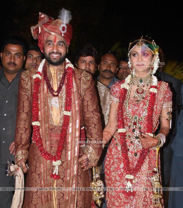Bollywood Actress Shilpa Shetty and London based businessman Raj Kundra pose for the media after their marriage Ceremony in Khandala