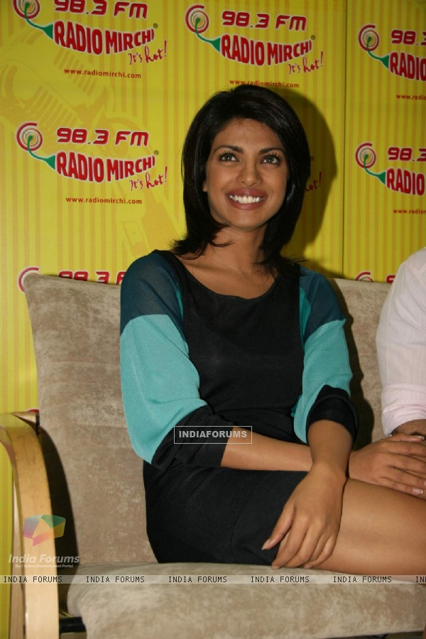 "Bollywood actress Priyanka chopra poses for shutterbugs after unveiling the music of ""Pyaar Impossible"" at a radio station in mumbai today afternoon"