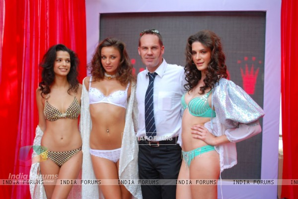 Models pose for the photographers during the unveiling of Triumph International Spring/Summer 2010 Collection at the 10th India Fashion Forum, The Renaissance, Pawai in Mumbai on Thursday, 28 January