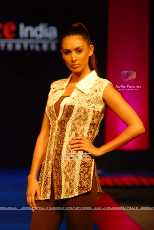 A model walks the ramp on the Day 2 of Source Fashion Show at Grand Hyatt in Mumbai