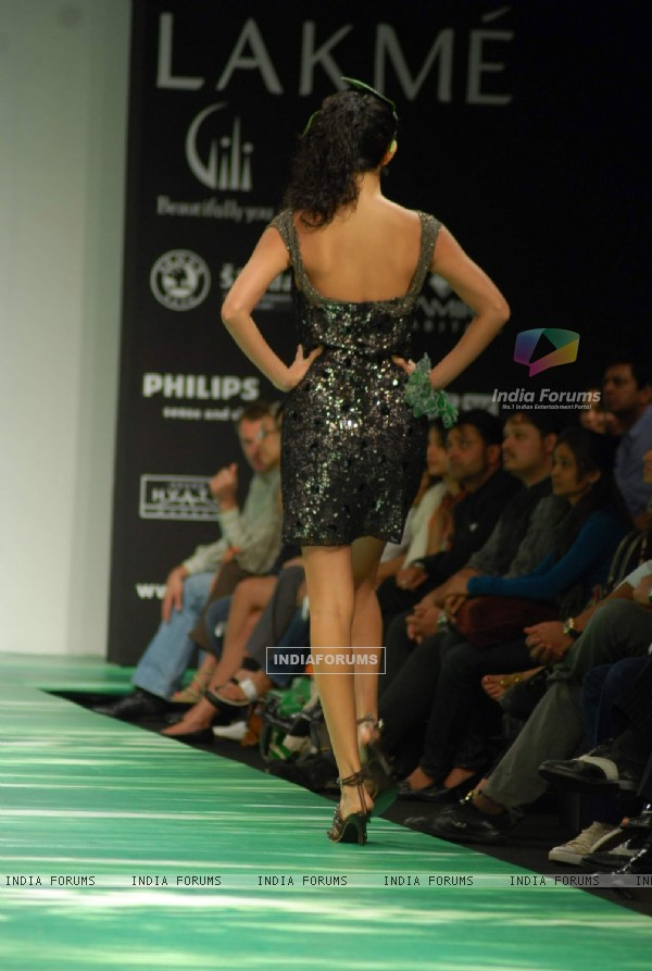 Model walks on the ramp for designer Leocanet Hemant at Lakme Fashion Week 2010