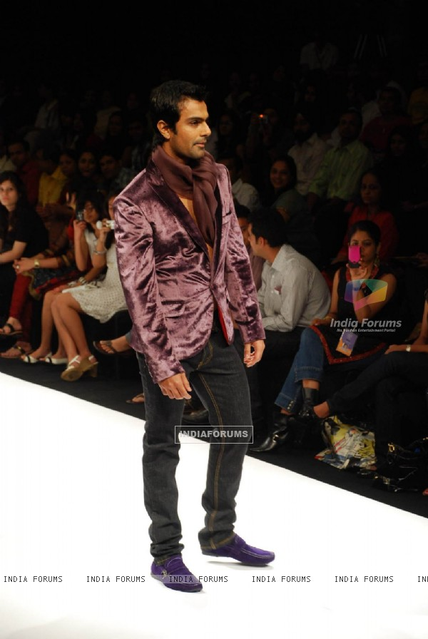 Model walks on the ramp for designer Harangad at Lakme Fashion Week 2010
