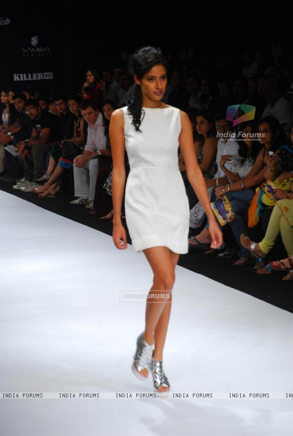 Model walks on the ramp for designer Walnut by nidhi & Divya Gambhir at Lakme Fashion Week 2010
