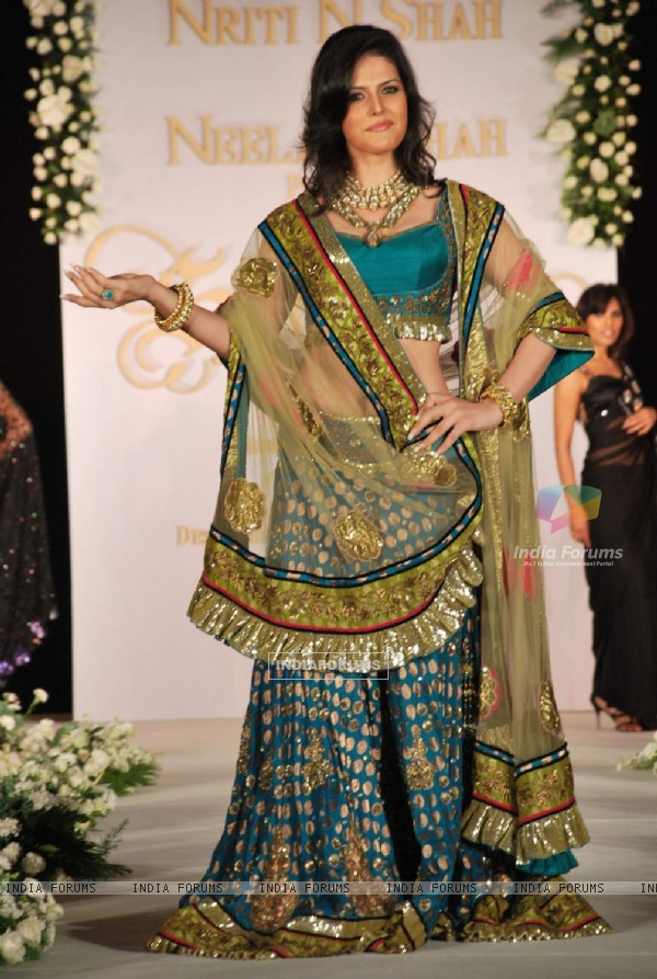 Zarine Khan walks the ramp for designers Nirati and Neelam Shah