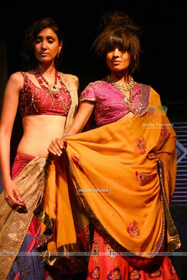 Models showcasing  designers Rahul,Gunjan and Payal Gupta''s creations  at the unveiling of bridal collections