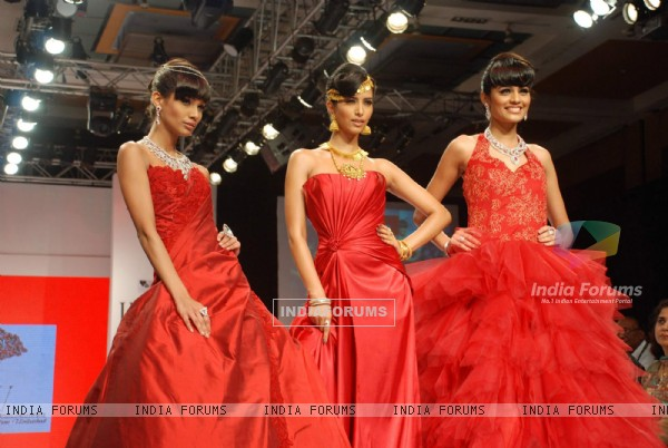 Models walk on the ramp at India International Jewellery Week