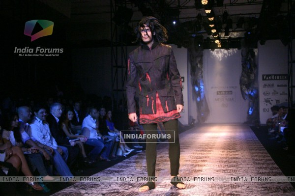 A model showcasing designer Shantanu & Nikhil''s creations at the Ven Heusen India Mens Week, in New Delhi