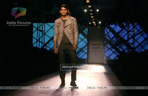 A model showcasing designers Rohit Gandhi and Rahul Khanna''s creation at the Ven Heusen India Mens Week, in New Delhi