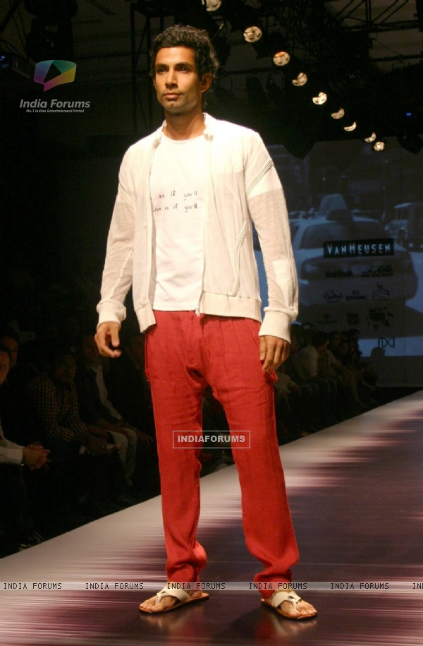 A model showcasing designers Karan Johar and Varun Bahl''s creations at the Ven Heusen India Mens Week, in New Delhi