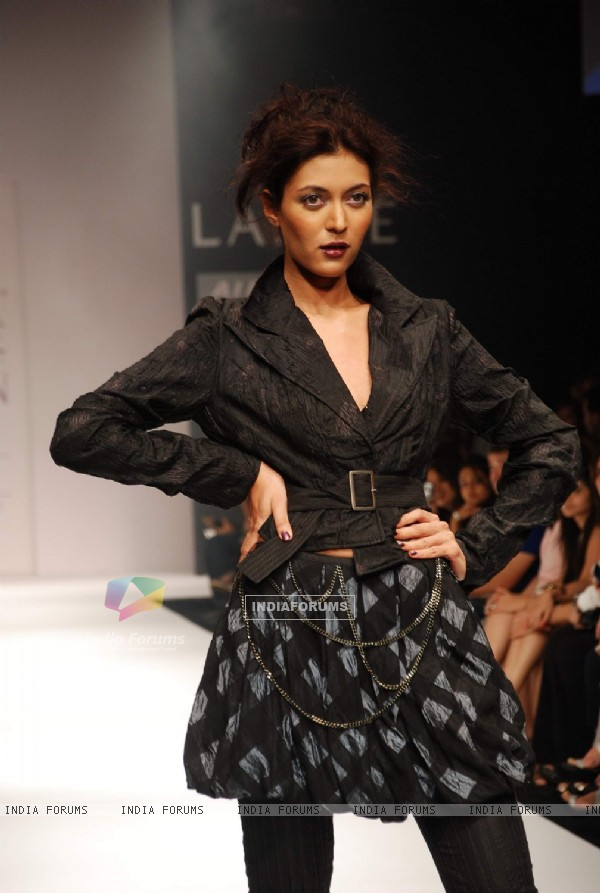 A model walks the runway in an Viia design at the Lakme Fashion Week