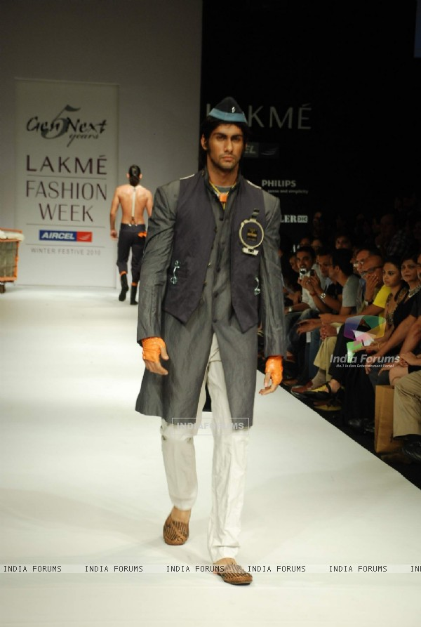 A model walks the runway in an Gen Next design at the Lakme Fashion Week