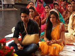 RK Sits in a Puja along with Madhu