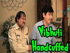 Why is Vibhuti ji handcuffed?