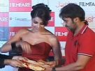 Ajay Devgan and Bipasha Basu unveil the latest issue of Filmfare
