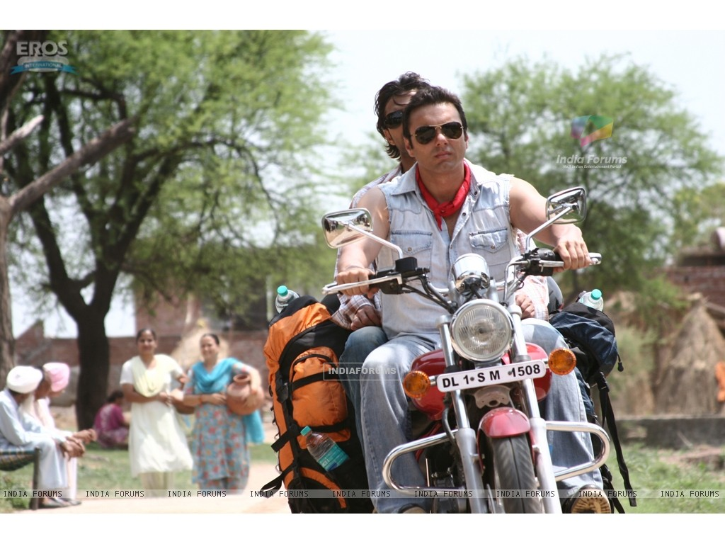 Sohail and Vatsal sitting on a bike (11969) size:1024x768