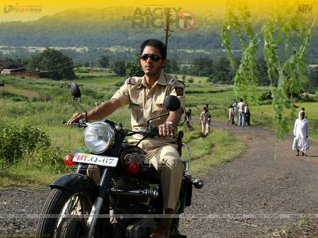 Shreyas Talpade riding a bike (15493) size:1024x768