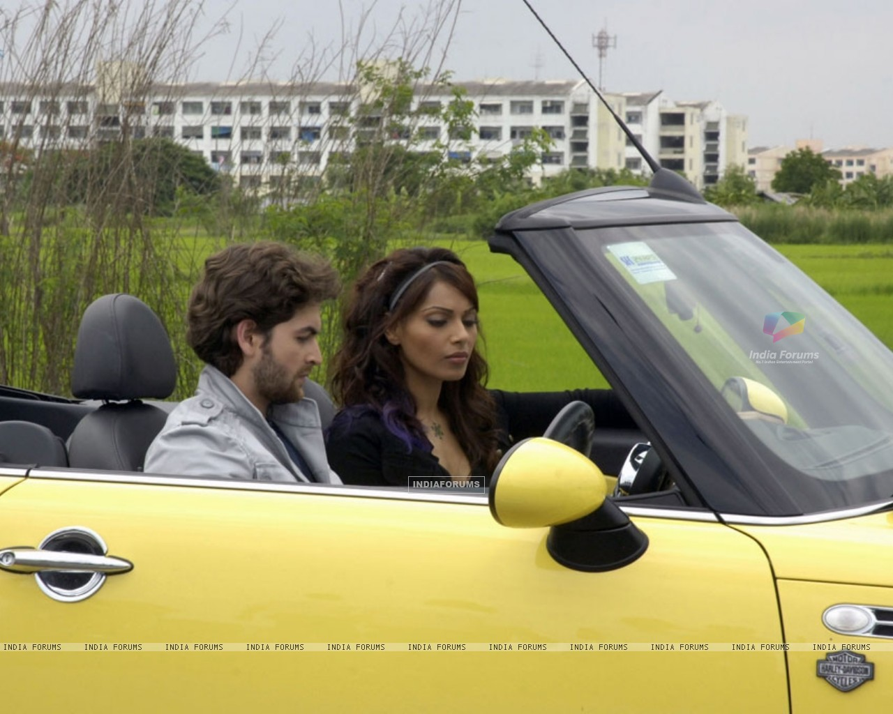 Neil and Bipasha listening a radio (11205) size:1280x1024