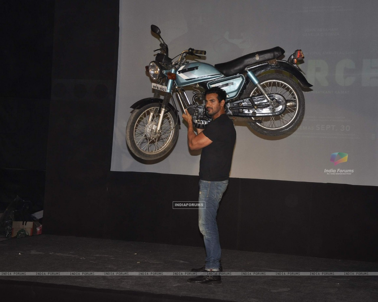 John Abraham lifts a bike at Force promotions in Mehboob, Mumbai (161342) size:1280x1024