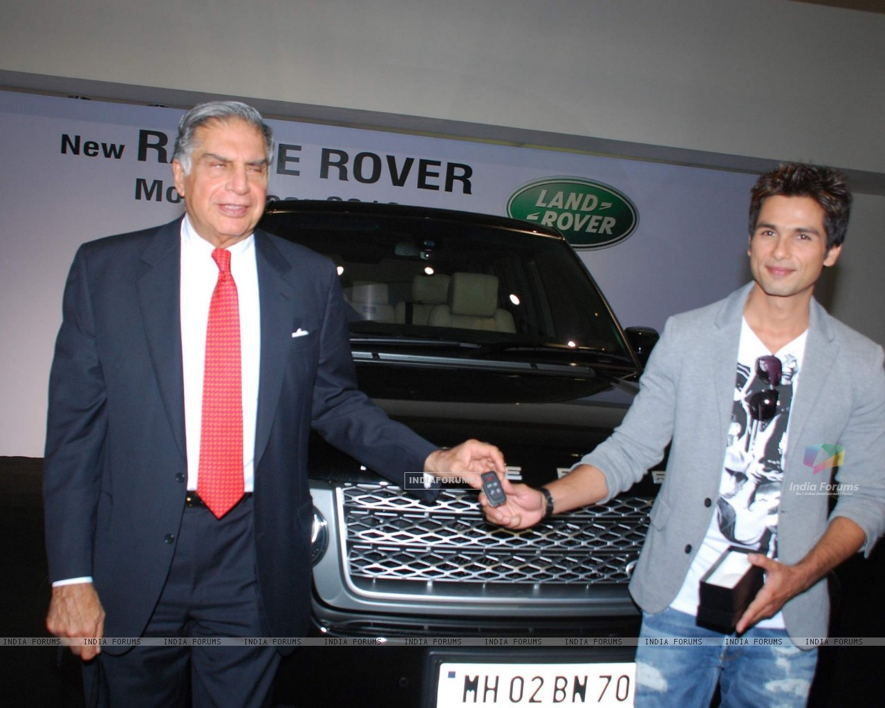 "Shahid Kapoor receiving the keys of his new Range Rover Model Year 2010 from Mr Ratan N Tata, Chairman, Tata Sons & Tata Motors, at the Jaguar Land Rover Showroom in Mumbai on 2nd November 2009 Mr Kapoor purchased this Range Rover"" (81775) size:1280x1024"