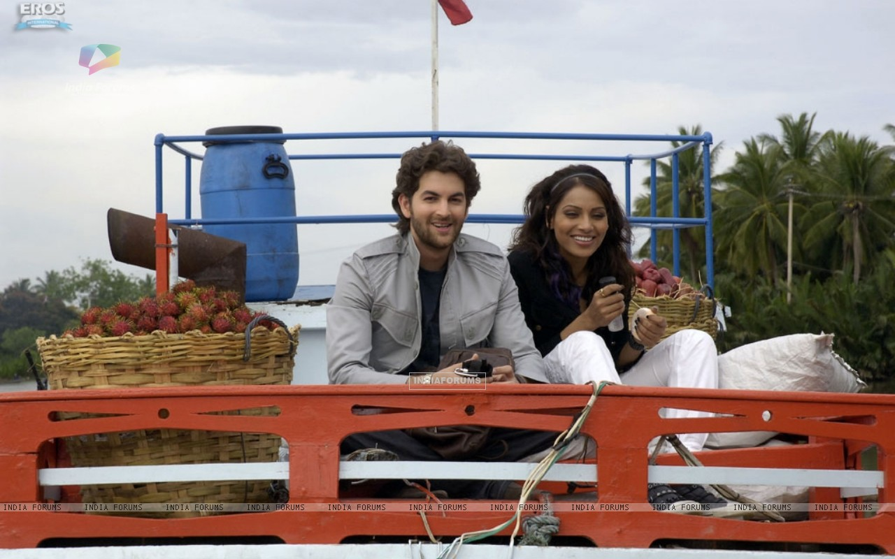 Neil and Bipasha sitting on a truck (11208) size:1280x800