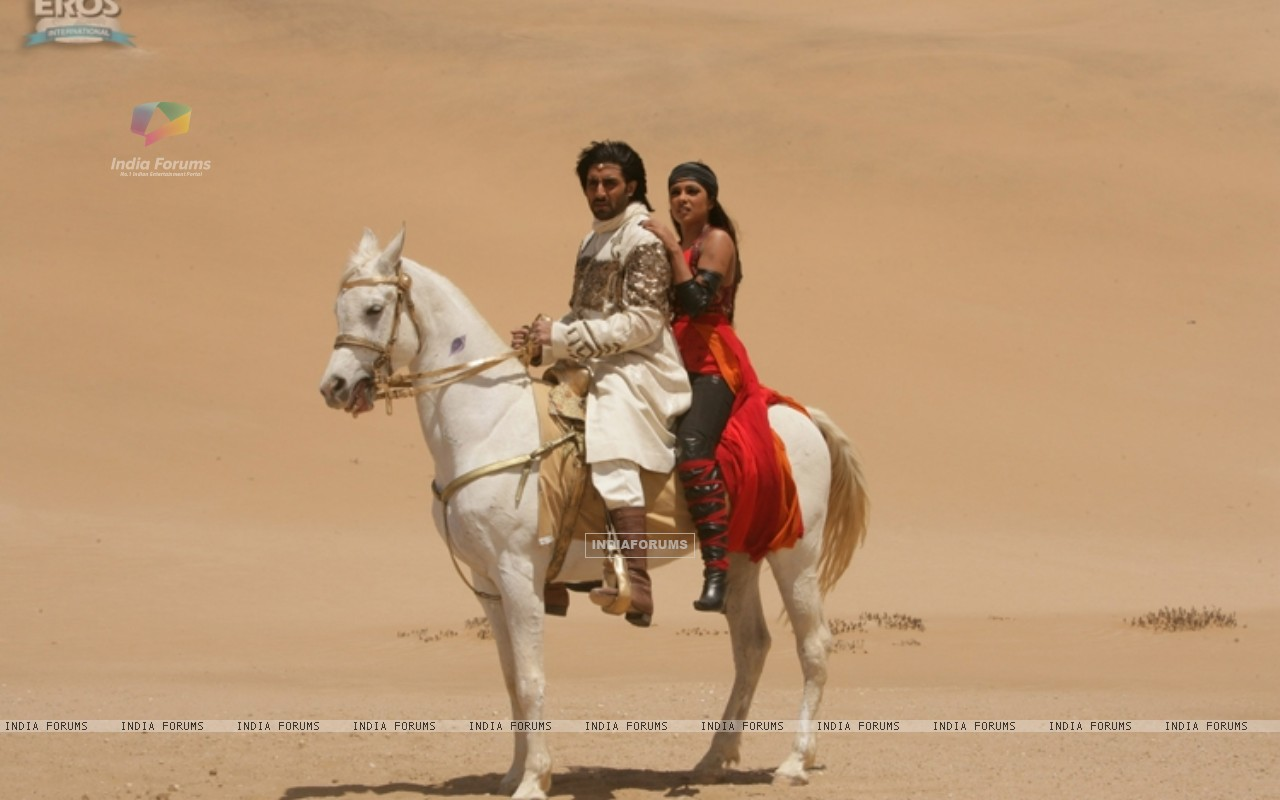 Abhishek and Priyanka sitting on a horse (11321) size:1280x800