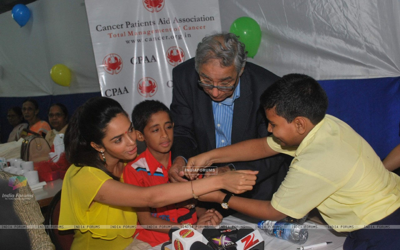 Bollywood actress Mallika Sherawat meets CPAA patients in Mumbai . (217382) size:1280x800