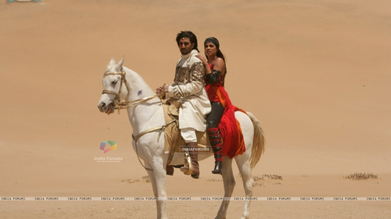 Abhishek and Priyanka sitting on a horse (11321) size:1366x768