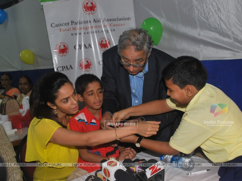 Bollywood actress Mallika Sherawat meets CPAA patients in Mumbai . (217382) size:800x600